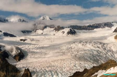 Large icefields covering the valleys between high rocky mountains