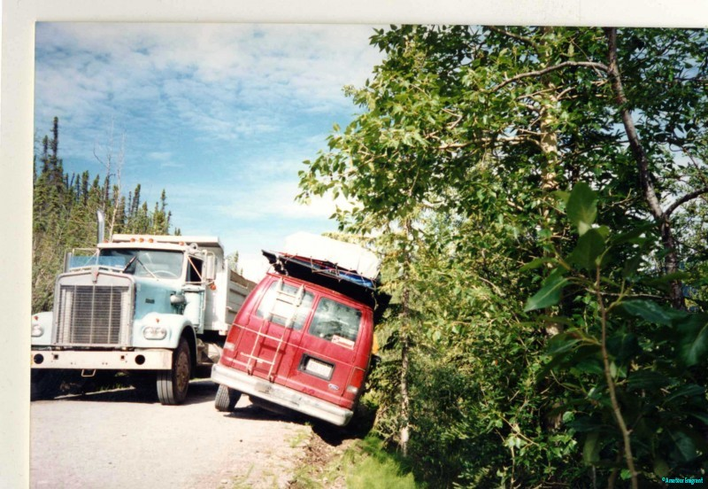 In the ditch - our rescuer. After some time trying to figure out how to get out of this situation, a timber truck the size of a house came along and plucked us from the roadside like a daisy