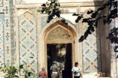 Locals entering mosque, note style of dress