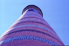 Minaret Bokhara covered in thousands of coloured tiles in intricate patterns