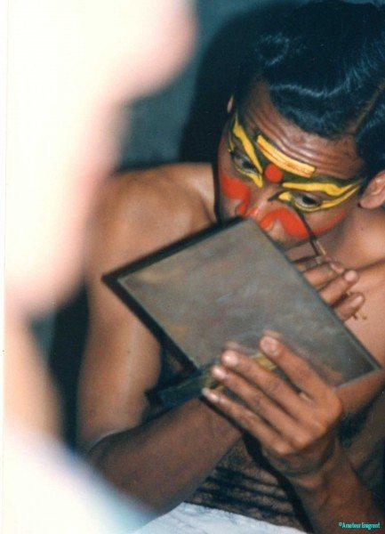 Covert-shot-of-Kathakali-dancer-applying-make-up-with-stick-Cochin-Kerala-India
