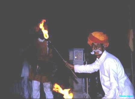 Elderly-retainer-livens-up-dinner-at-palace-in-Shekhavati-Rajasthan-India