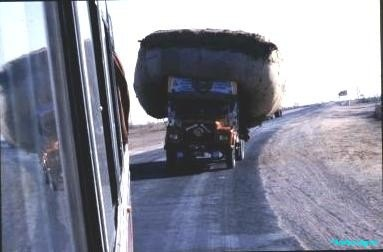Looking-back-from-minibus-window-an-ambitious-driver-wanting-to-pass-with-a-load-that-takes-up-all-the-road