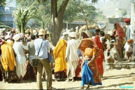 Spoilt for choice; a tourist views the colourful festival crowds