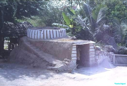 Lime kiln, Tamil Nadu. Rocks are piled in the top, wood in the bottom to break down into lime for cement