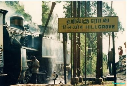 A steam train being filled with water