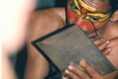 Covert-shot-of-Kathakali-dancer-applying-make-up-with-stick-Cochin-Kerala-India