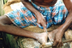 Making-combs-from-buffalo-horn-note-use-of-toes-as-vice.-Tamil-Nadu-India-1
